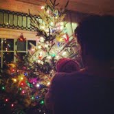Peaceful baby, dancing with Daddy by the tree.