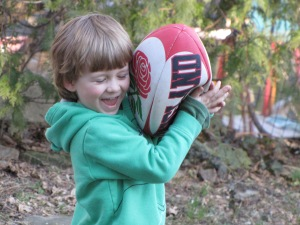 Backyard rugby practice in early Spring