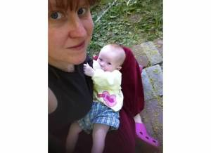 I picked this one because it's one of the last pictures I have of us nursing: E's about 7 months old here.  And also because it's OUTSIDE (last May or June) and there was GREENERY in the world, hard as that is to imagine when it's -8 on these frigid March mornings.
