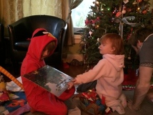 Caleb (in his new Angry Bird pajamas) and Evanny opening presents on Christmas morning 2.0