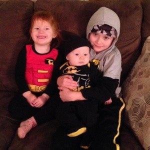 Bat-babies, with Robin--a cultural icon that just seems to keep following us through our celebrations (two or three kids were Batman at Evanny's birthday party, and you can see the caped one crashing Caleb's party too (okay, Nate WAS invited)!
