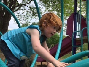 Playground daredevil is delighted to meet new climbing challenges as soon as they present themselves.