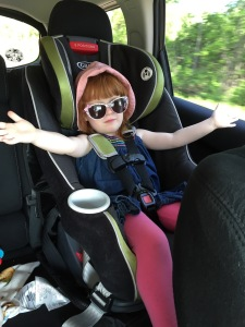 Little Miss glam girl rocking out her Minnie Mouse sunglasses and those long, long legs.